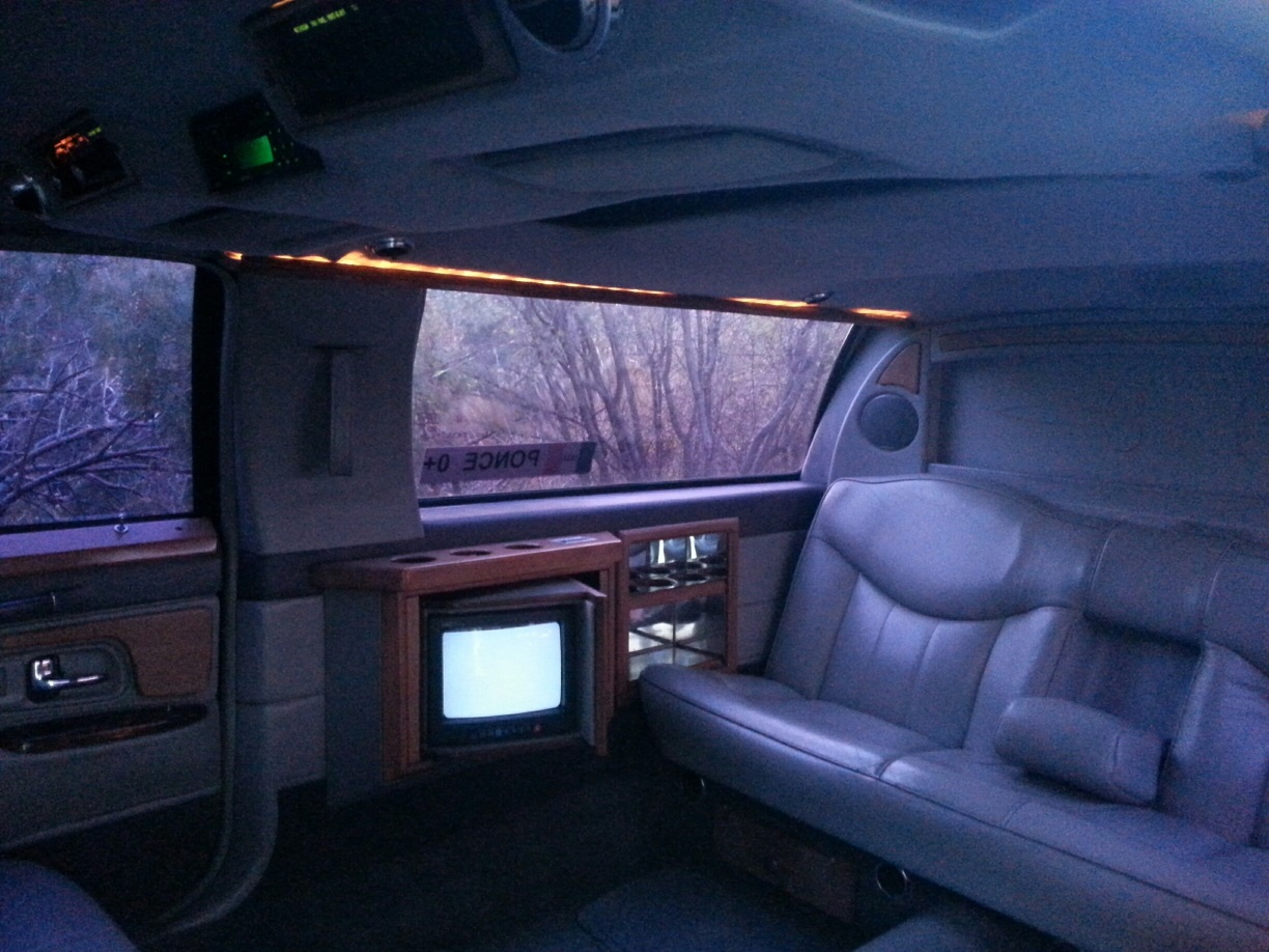 Limo seats 4-6 and is equipped with Bar, TV, VCR, DVD, SIRIUS RADIO & SAT PHONE.